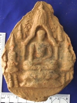 Votive tablet depicting a sikhara with trefoil arch and Buddha with twelve stupas